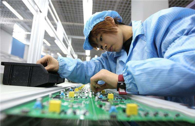Workers are working on PCB assembly